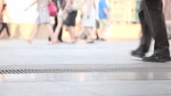 HD Dolly:People are very busy on the sidewalk. video