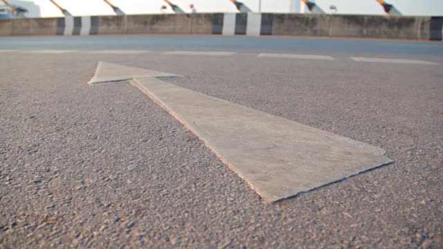 Dolly:Symbol arrow on the road surface. video
