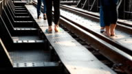 HD Dolly:Tourists walking on the bridge over the River Kwai. video