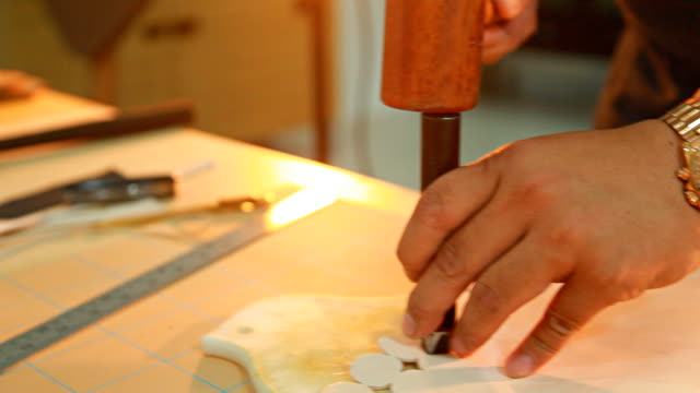 HD Dolly:Use a chisel hammer down on the white leather. video