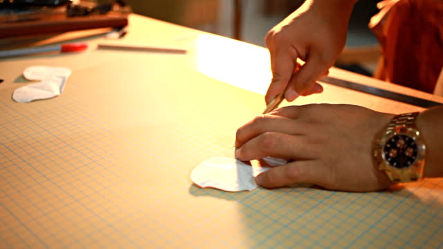 HD Dolly:Using a paper cutter on the table. video