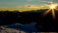 Dolomite Alps, winter cabin sunset time lapse video