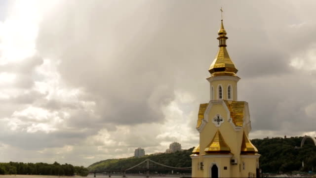 Dome of a church against a cloudy sky background video