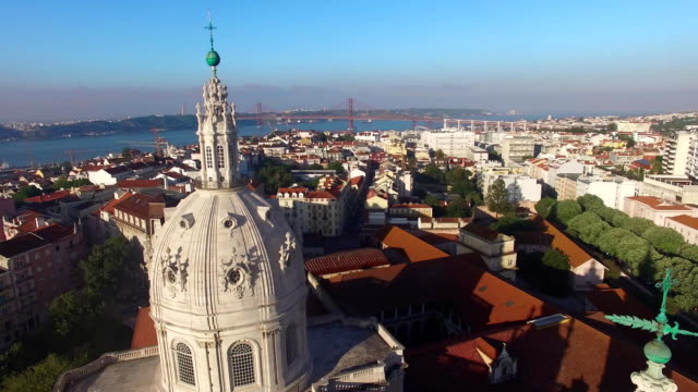 Dome of the Estrela Basilica on a background of Lisbon at morning aerial view video