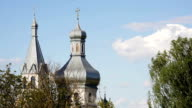 Domes of Orthodox Church against background of blue sky video