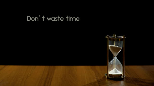 Don't waste time, popular phrase about life value and transience, sandglass video