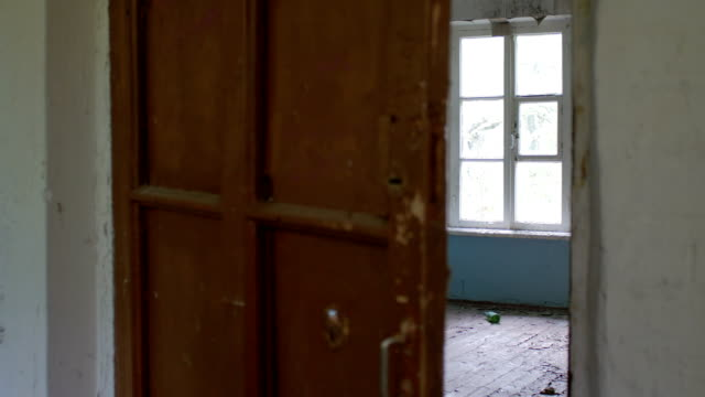 door in old house is opening independently, nobody, old empty room, abandoned house, scary scene video
