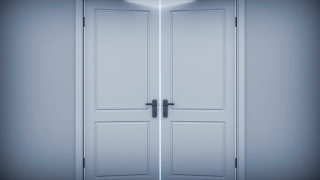 Doors opening to a bright light. video