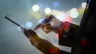 Double exposure businessman using digital tablet video