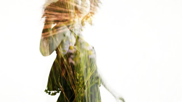 Double Exposure of afro girl spinning over golden fields video