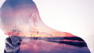 Double Exposure of Sunset and Young Man video