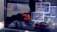 double exposure shot of man hacker working at a laptop video