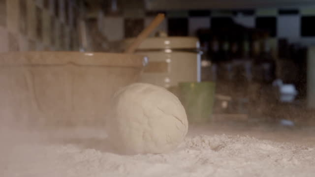 Dough Hitting Flour In Slow Motion video