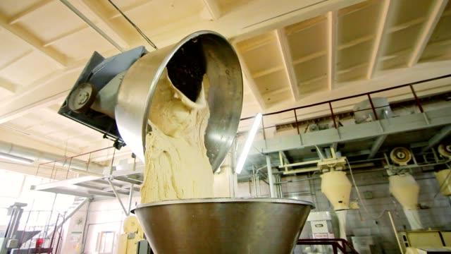 Dough mixing machine in bread factory. Wheat flour dough at baking factory video