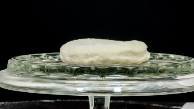 Dough rising on a glass plate timelapse video