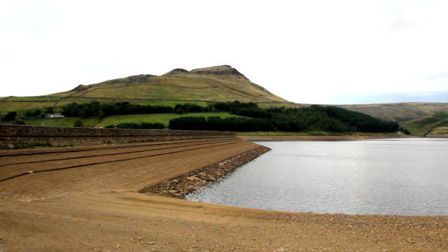 Dove Stone reservoir low level after dry summer panning right video