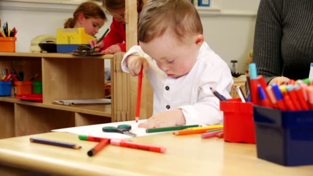 Down Syndrome Boy at Nursery video