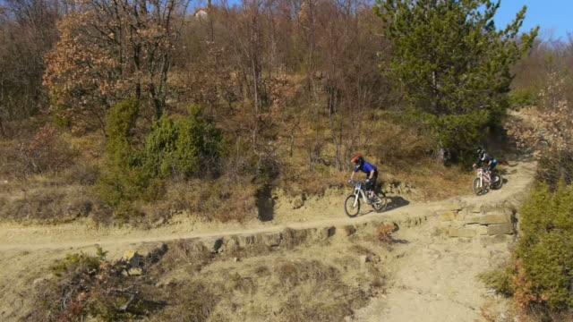 HD: Downhill Bikers Riding Along Trail video