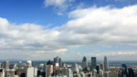 Downhill view of the Montreal city skyline on a sunny autumn day video