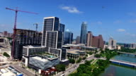 Downtown Austin Aerial Drone Footage with Helicopter Flying around New Construction in 4K video