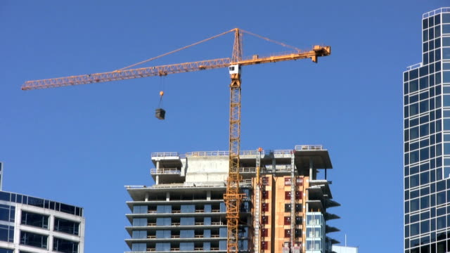 Downtown Construction Crane On Sunny Day (HD 1080p30) video
