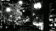 Downtown lights in grainy black and white video