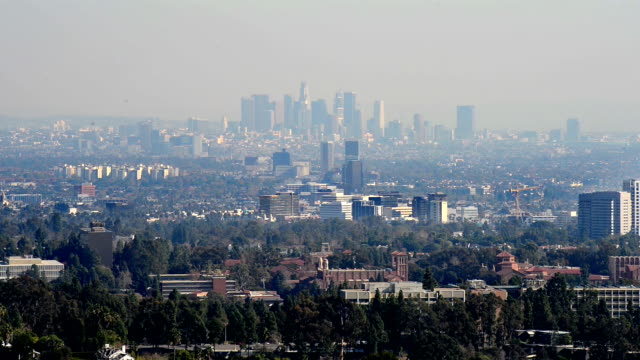 Downtown Los Angeles skyline over blue cloudy sky video