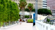 Downtown Tampa, people walking by river video