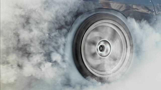 Drag racing car burns rubber off its tires for the race video