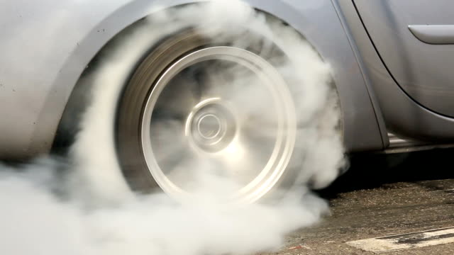 Drag racing car burns rubber off its tires video