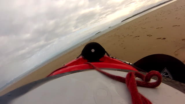 Dragging a Kayak Across a Beach video