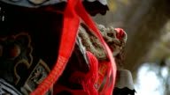 Dragon & metal bell on censer,red ribbon blowing in wind. video