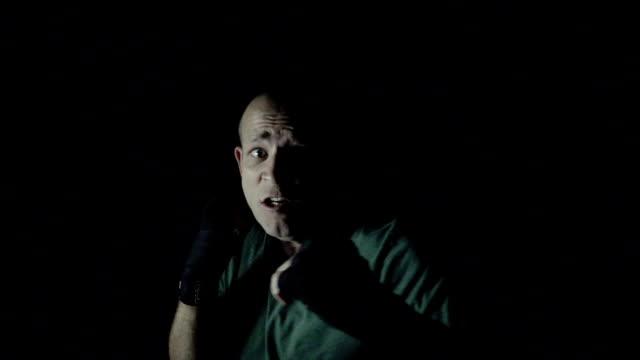 Dramatic boxing, man punching at camera video