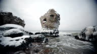 Dramatic frozen demolished forts ruins in Baltic sea, Liepaja, Latvia video