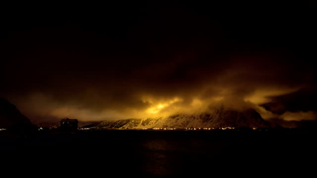 TIME LAPSE: Dramatic Night Sky at Arctic Fjord video