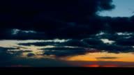 Dramatic scene of sunrise clouds over wheat field video