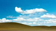 Dramatic scene of white clouds over wheat field video