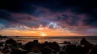 Dramatic sea sunset on rock shore video
