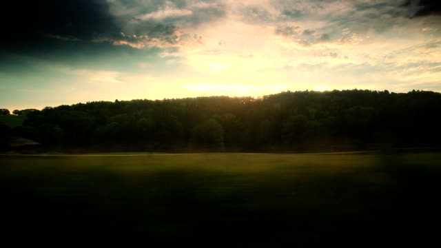 Dramatic sky out of the window in moving train video