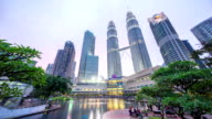 Dramatic sunset at Kuala Lumpur City Centre fountain park where sky turn pink and blue as the sun goes down video