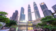 Dramatic sunset at Kuala Lumpur City Centre fountain park where sky turn pink and blue as the sun goes down. video