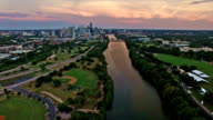 Dramatic Sunset Brings Colors to Texas Hill Country Downtown Austin Texas City Skyline Over Colorado River video