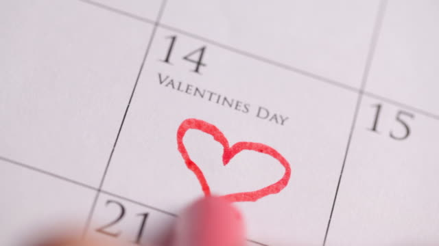 Drawing a heart for Valentines Day on Calendar video