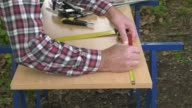 Drawing a melamine panel with a square and a pencil video