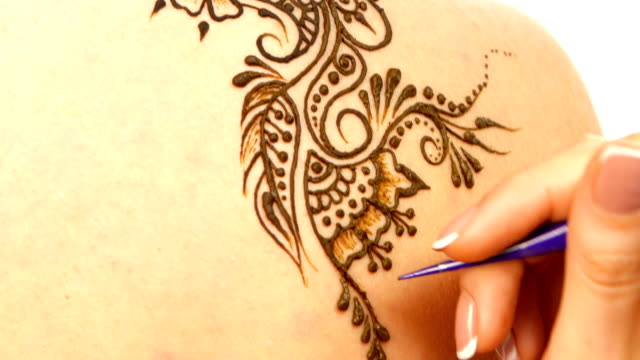 Drawing process of henna mehendi ornament on back, white video