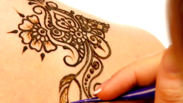 Drawing process of henna mehendi ornament on shoulder video