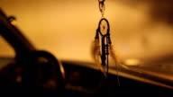 Dream catcher decoration in vintage car video