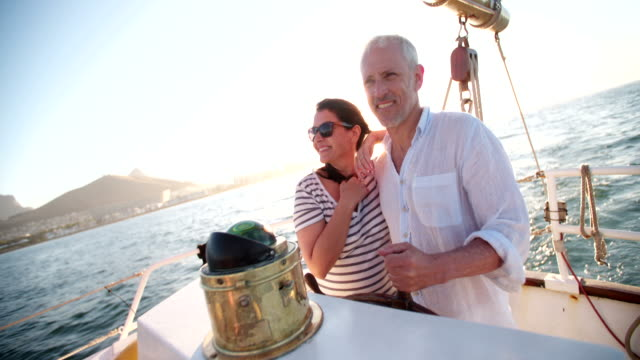 Dreamy vintage shot of senior couple enjoying a leasure cruise video