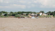 Dredging boat floating on the river and collecting sand from the river bed video