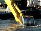 Dredging Sediment Mud From Under Water, Scoop Goes In video